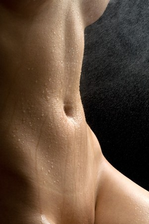 Anonymous nude with water spray on black background Stock Photo - 4449276