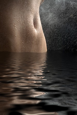 Anonymous nude with water spray on black background Stock Photo - 4449278