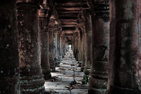 Long stone corridor in Cambodian temple ruins