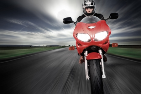 fast forward: Motorcycle moving very fast along motion blurred road Stock Photo
