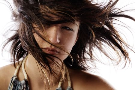 blown: Cute brunette face shot with windblown hair