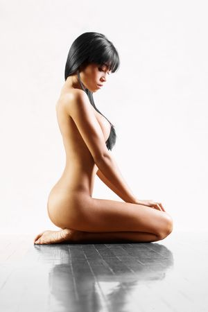 Beautiful Asian girl naked on white studio background Stock Photo - 6612103