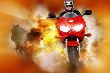 atomic explosion: Stuntman riding motorbike on orange and yellow abstract background Stock Photo