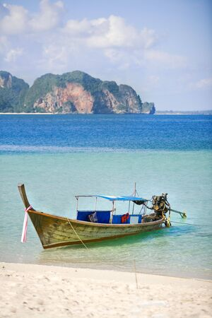 long tailed boat: Thai Long tailed boat on island shore Stock Photo