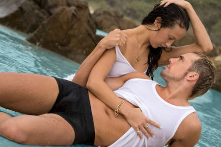 Sexy young couple on beach in underwear photo