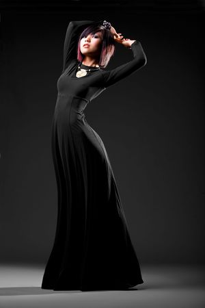 Asian model wearing elegant dress with studio background photo