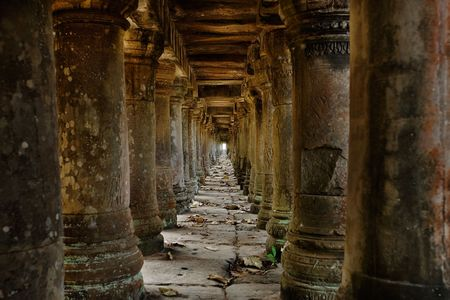 Long stone corridor in Cambodian temple ruins