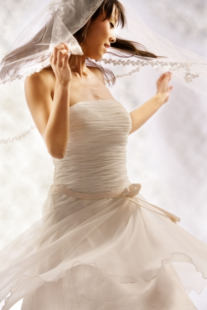 Bride dressing in white spins around happy Stock Photo