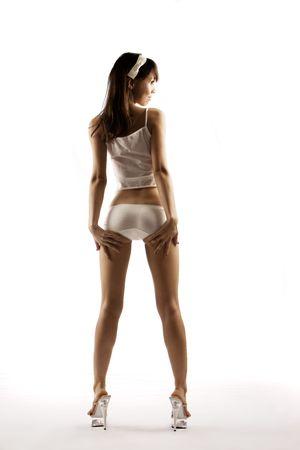 Thin model in wet, see through underwear on white background
