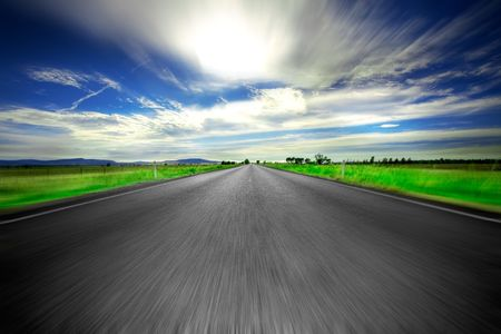 Road going straight ahead with motion blur Stock Photo