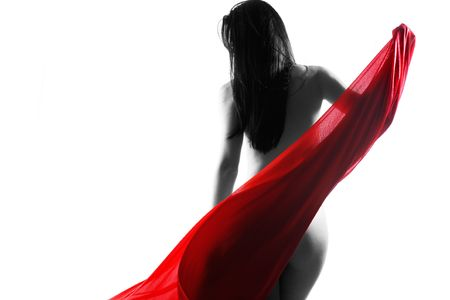 Art nude with red flowing cloth on white studio background