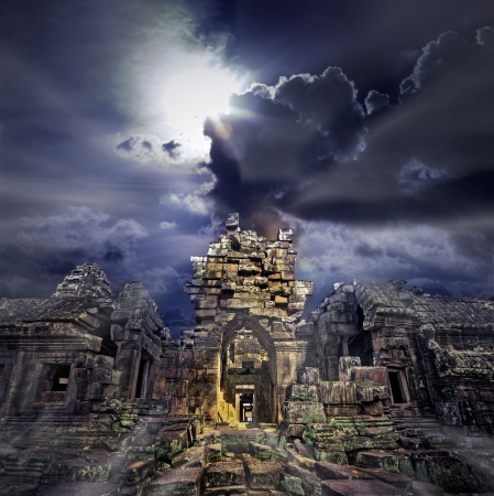 buddhist structures: Cambodian temple ruins turning to rubble, blue sky background Stock Photo