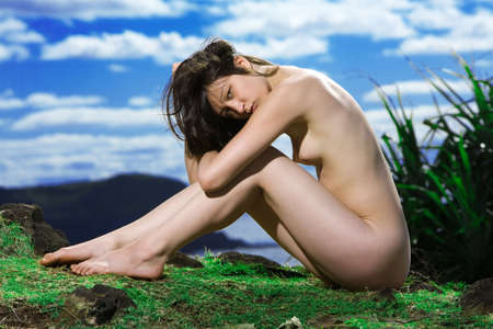 Beautiful nude girl on grass hill with blue sky in background Stock Photo - 7172174