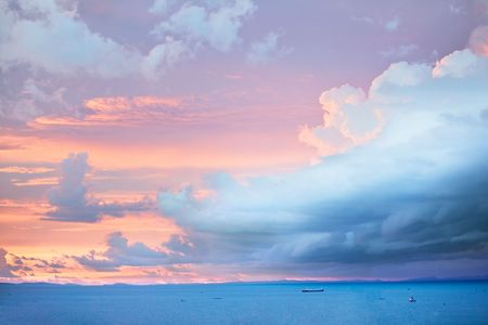 A seaside storm rolls in aat sunset, pastel colours Stock Photo