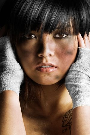 Cute Asian girl covered in dirt and grease photo