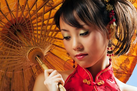 Chinese girl with parasol wearing a cheongsam Stock Photo