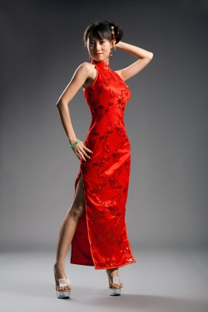Chinese woman in cheongsam with studio background Stock Photo