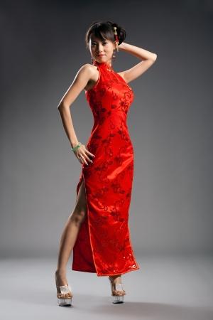 Chinese woman in cheongsam with studio background Stock Photo