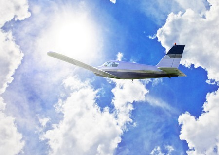 Small plane flying through sky with sun in background Stock Photo