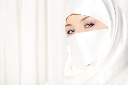veil: Arabic woman wearing white Hijab on white background