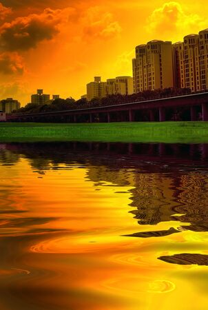 suburbian: Singapore scene with vivid colors, lake and sunset in background