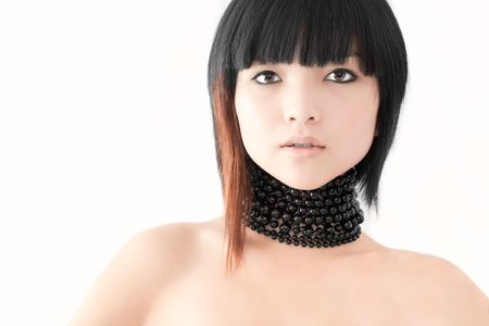Beautiful Asian fashion model on white studio background Stock Photo