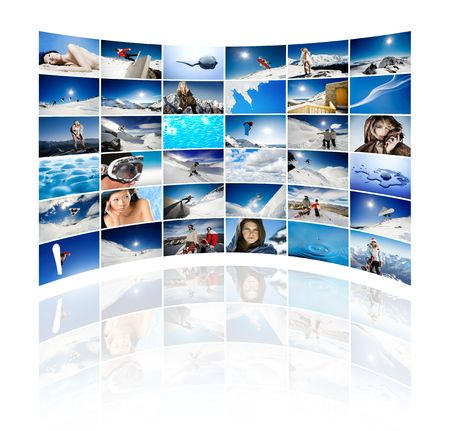 Curved wall of tv screens showing winter, snow and ice themed images Stock Photo