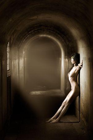 artistic nude: Artistic nude of beautiful woman in tunnel