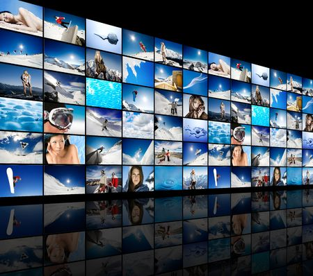 Wall of tv screens showing winter, snow and ice themed images Stock Photo