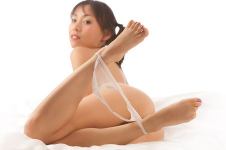 Asian woman naked on white bed and background