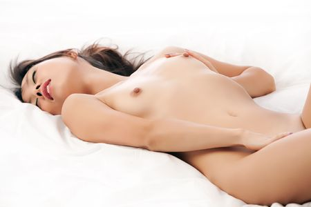 Beautiful Chinese woman on white bed and background