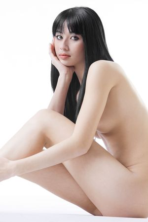 Beautiful Eurasian woman naked on white studio background Stock Photo