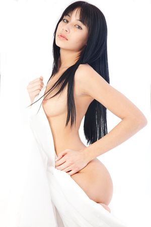 Beautiful Eurasian woman naked on white studio background photo