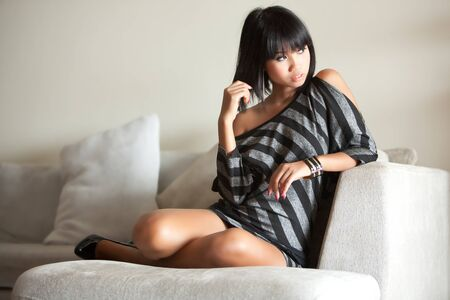 Beautiful Thai girl lounges around at home photo