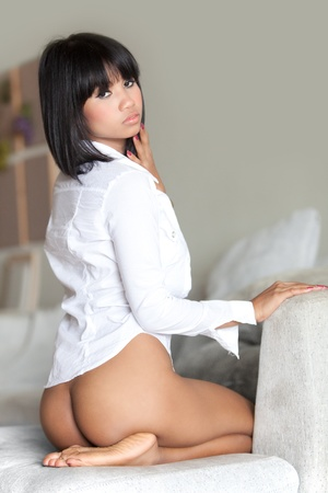 Sexy Thai glamour model sitting on couch