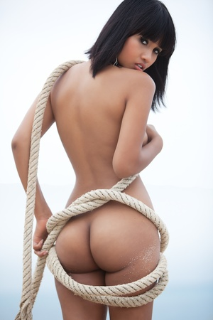 Beautiful Asian model outdoors, naked with rope Stock Photo