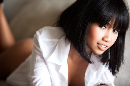 Beautiful Asian woman naked under white shirt