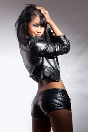 Beautiful Thai fashion model in leather outfit photo