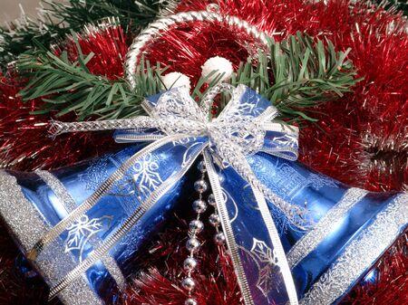 Decorative blue christmas campanellis on a background garlands                       photo