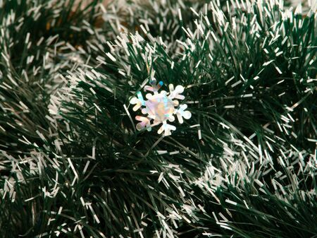 Decorative snowflake on a background garlands                               photo