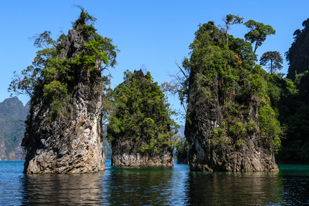 Three bars stand together in sea (Guilin of Thailand) at Cheow lan lake,Ratchaprapha dam,Suratthani,Thailand.(KHAO SOK National Park )