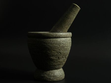 morter: mortar on a black background .The light from the right of the image