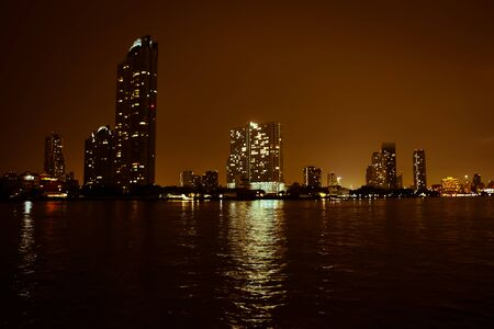 Bangkoks Chao Phraya river at night . Stock Photo