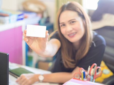 Asian beautiful Women working in office. and show the Credit Cards. Financial of Women concept. Stock Photo