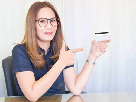 Asian business Woman working in office. and show the Credit Cards. Financial of Women, concept.