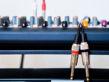 rear end: Audio jack cable and music mixer. Stock Photo
