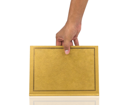 man hand holding Book with gold cover isolated on white background. clipping path.