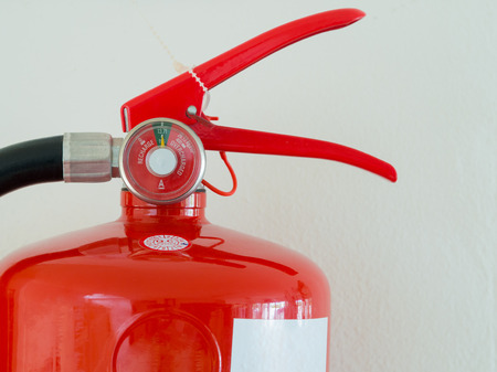 close up, Fully Charged Meter on red Fire Extinguisher. Reklamní fotografie - 83475602