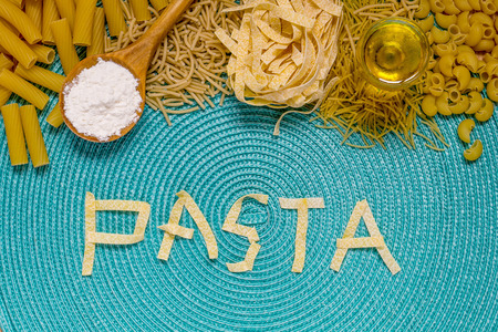 pennie: food lettering with mixed dried pasta selection Stock Photo