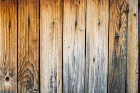 parquet texture: rustic weathered barn wood background with knots and nail holes, horizontal view texture old panels Stock Photo